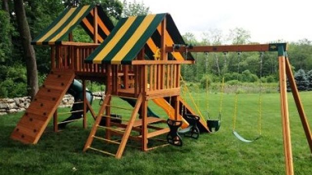 wooden swing set with double canopy