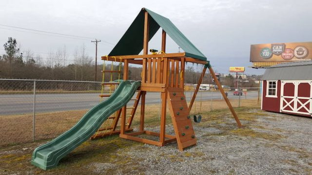 Cedar playset on display at swing set retailer