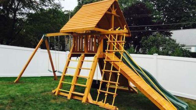 wooden backyard swing set