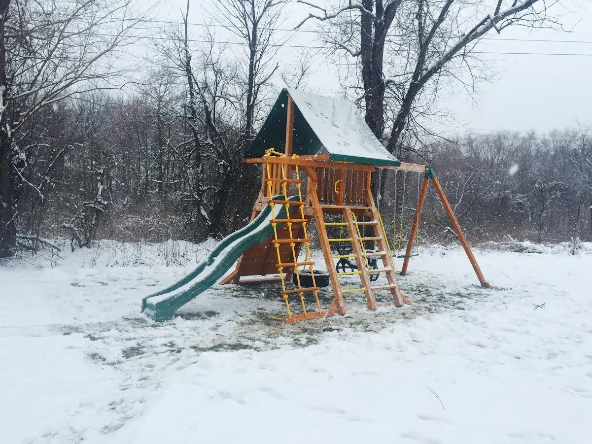 supreme swing set in the snow